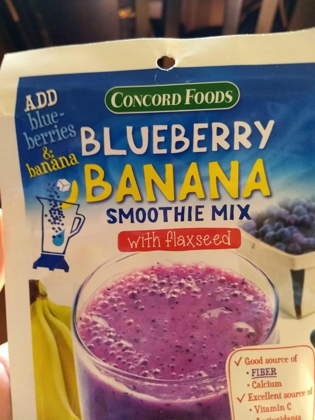 false advertising - Food - ADD blue- CONCORD FOODS bereries BLUEBERRY banana ΒΑΝΑΝΑ SMOTHHES MIX with flaxseed Good source of FIBER Calcium of Excellent source Vitamin C tioridants