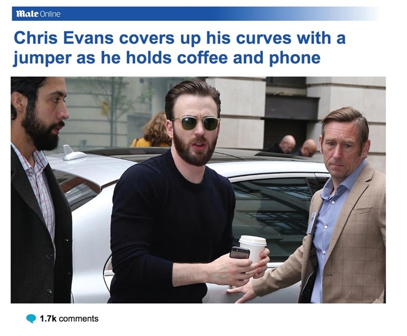 Product - Male Online Chris Evans covers up his curves with a jumper as he holds coffee and phone 1.7k comments