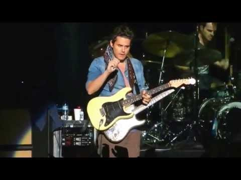 John Mayer takes fan's guitar on stage and plays his hit gravity and then signs and tunes the guitar before returning it.