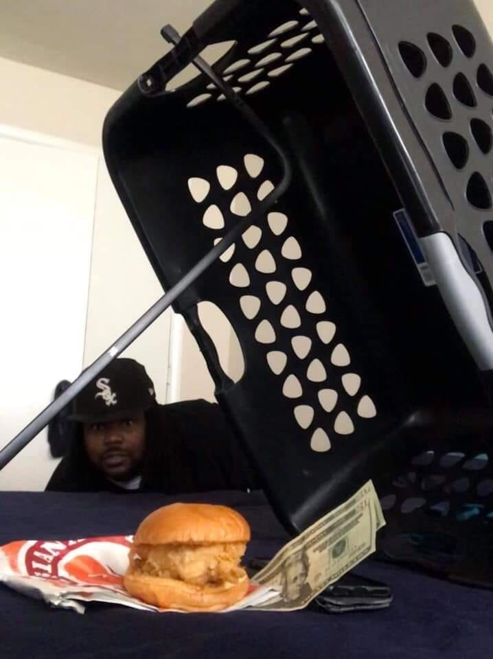 Funny picture of a trap set up with a chicken sandwich and some cash as a lure