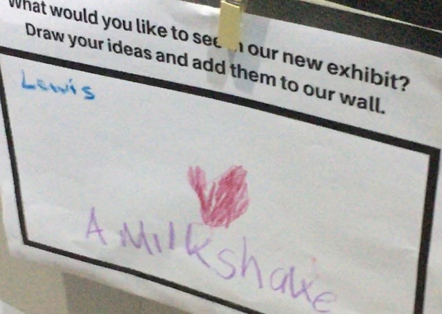 Text - would you like to secour new exhibit? Draw your ideas and add them to our wall LEwis AMRShake