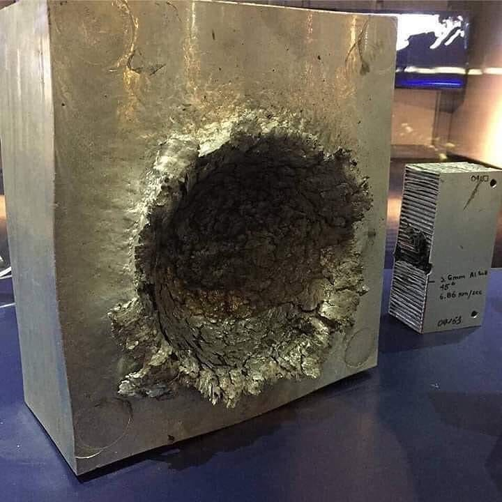 picture aluminium with huge hole in it from space debris