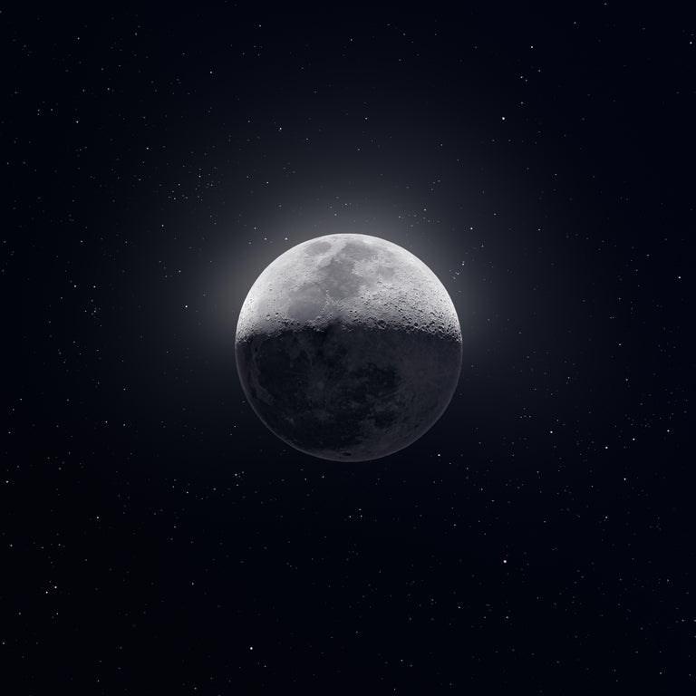 photo of the moon half in shadow