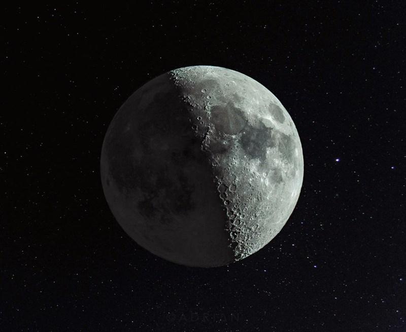 A photograph of a waxing crescent moon, illuminated 47.3%.