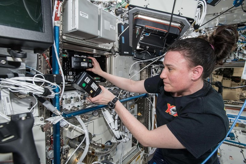 astronaut making cement inside iss
