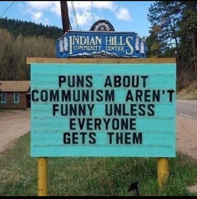 Street sign - INDIAN HILL COMMUNITY CENTER PUNS ABOUT COMMUNISM AREN'T FUNNY UNLESS EVERYONE GETS THEM