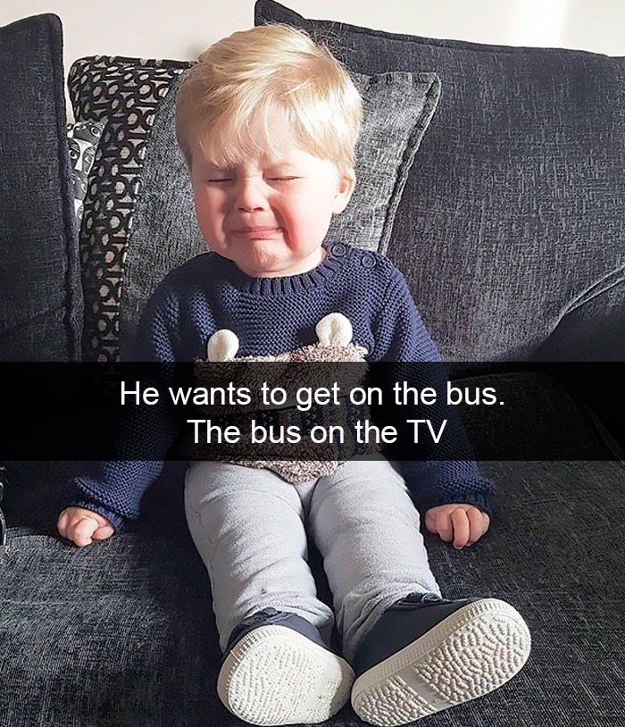 Child - He wants to get on the bus. The bus on the TV ww