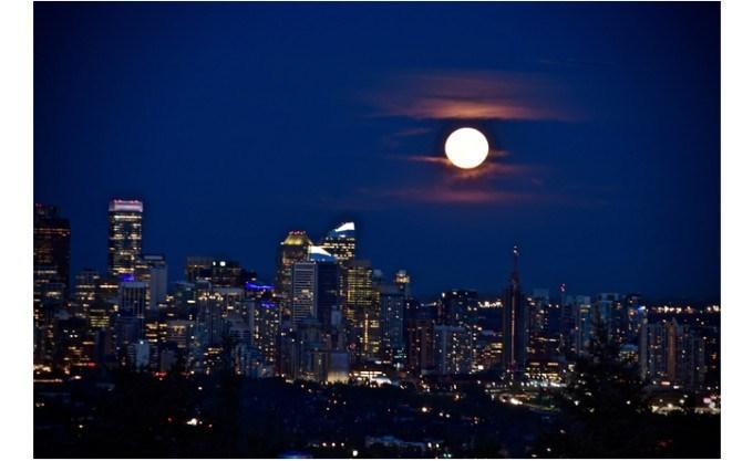 harvest moon above city