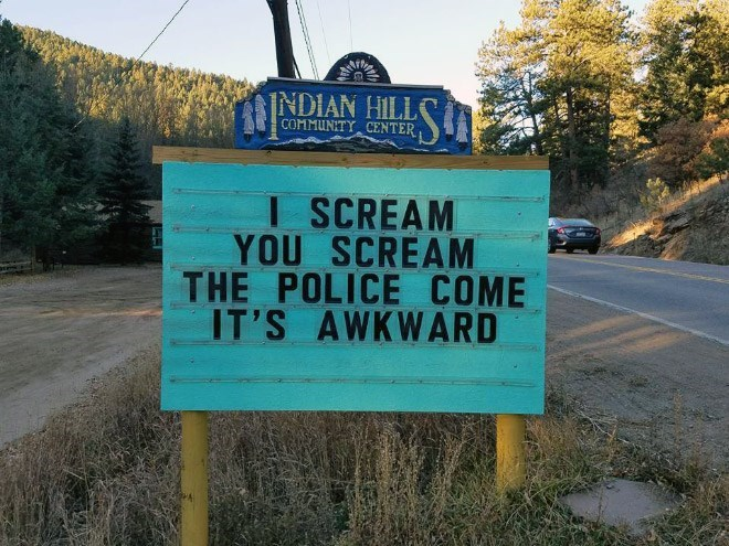 Street sign - NDIAN HILL COMMUNITY CENTER I SCREAM YOU SCREAM THE POLICE COME IT'S AWKWARD