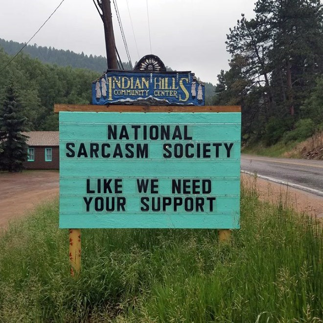 Street sign - INDIAN HILL COMMUNITY CENTER NATIONAL SARCASM SOCIETY LIKE WE NEED YOUR SUPPORT