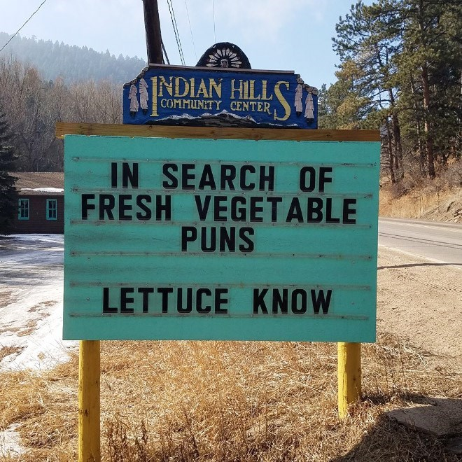 Street sign - INDIAN HILL COMMUNITY CENTER IN SEARCH OF FRESH VEGETABLE PUNS LETTUCE KNOW