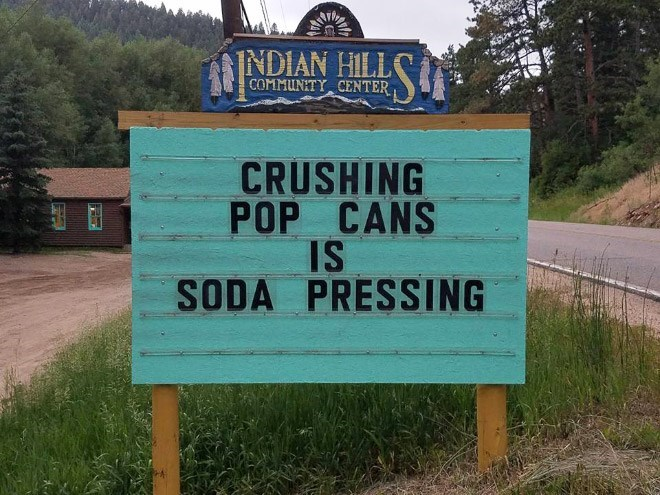 Street sign - INDIAN HILL COMMUNITY CENTER CRUSHING POP CANS IS SODA PRESSING