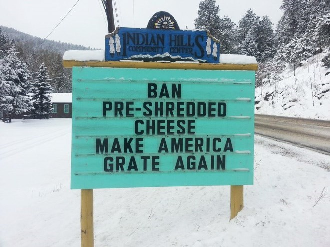 Street sign - INDIAN HILL COMMUNITY CENTER BAN PRE-SHREDDED CHEESE MAKE AMERICA GRATE AGAIN