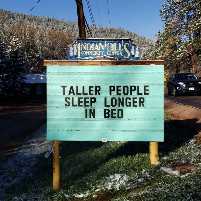 Street sign - NDIAN HILL COMMUNITY CENTER TALLER PEOPLE SLEEP LONGER IN BED