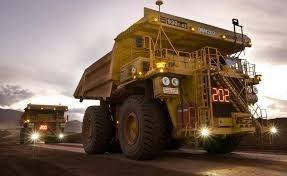 picture two large autonomous driverless trucks in australian desert