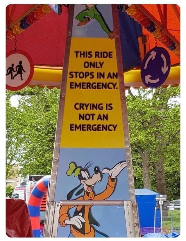 Sign - THIS RIDE ONLY STOPS IN AN EMERGENCY CRYING IS NOT AN EMERGENCY