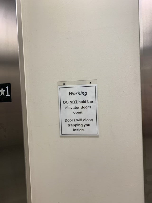 Text - Warning DO NOT hold the elevator doors open. Doors will close trapping you inside.