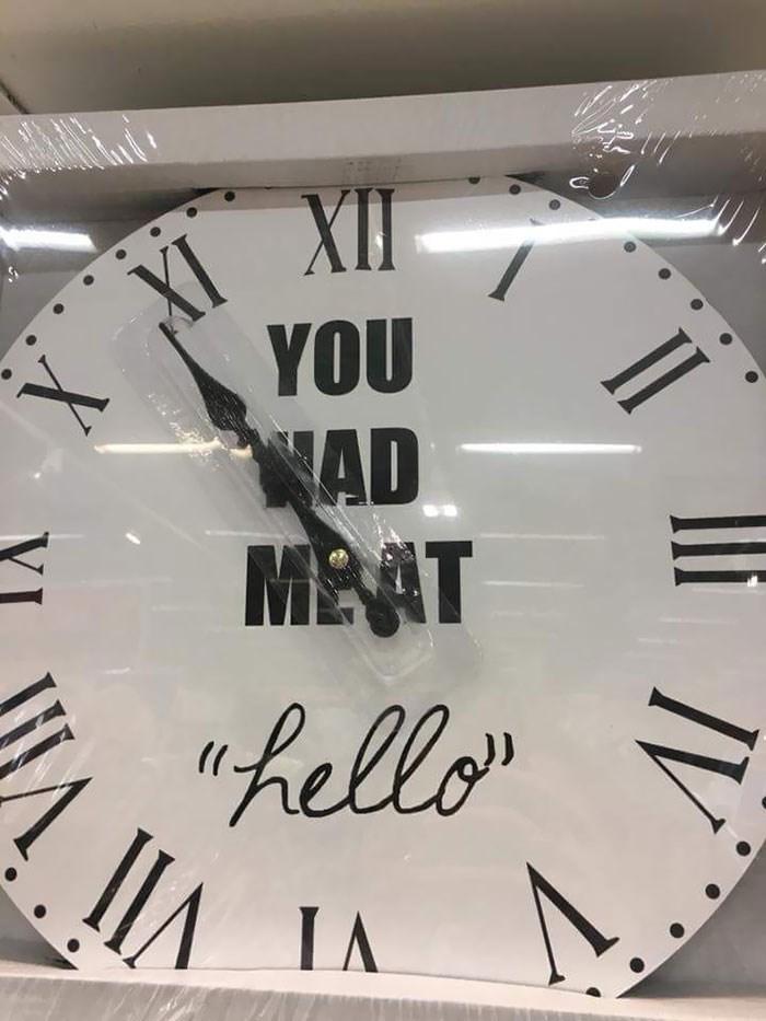 "Clock - XI XI YOU AD MEAT ""hello"" IA IA IV X"