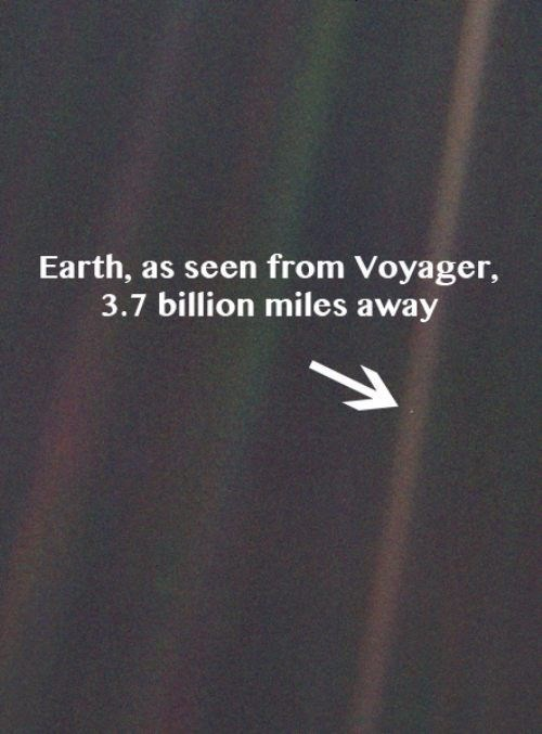 """Interesting space fact that reads, """"Earth, as seen from Voyager, 3.7 billion miles away"""" depicting earth as a tiny dot"""