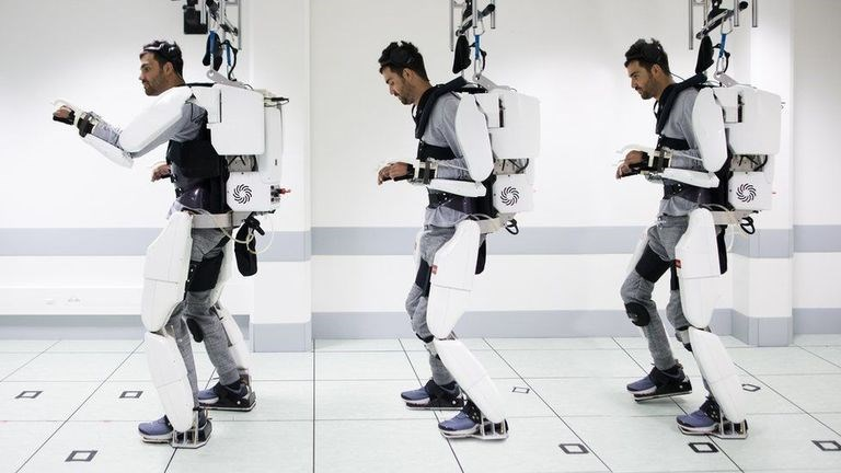 three tier photo of man in exoskeleton walking