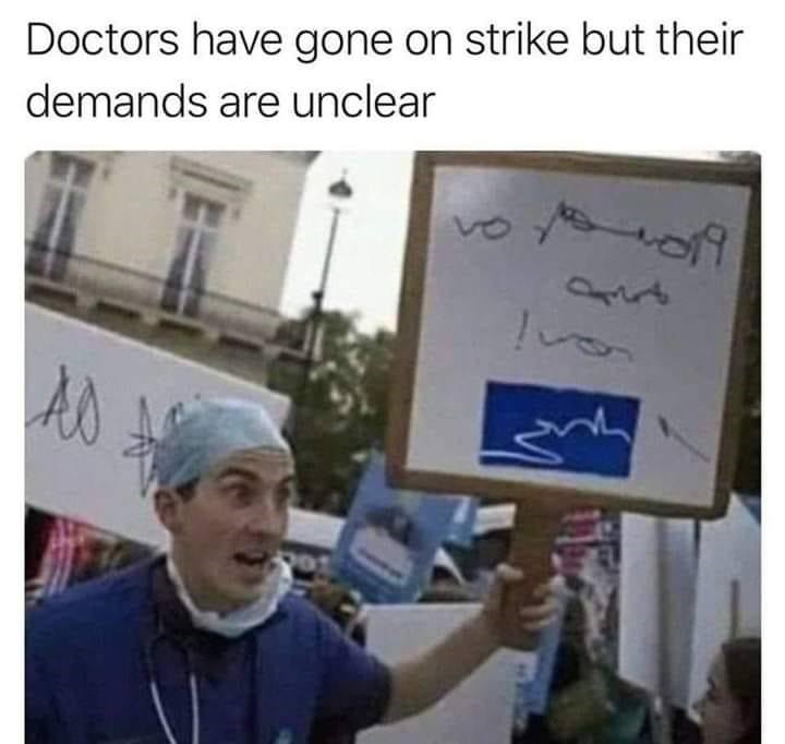 """Funny meme that reads, """"Doctors have gone on strike but their demands are unclear"""" above a photo of a doctor at a protest holding up a sign with chicken scratch"""