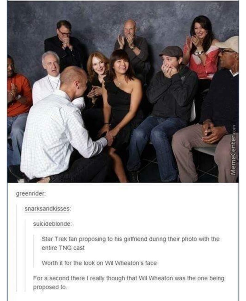 Product - greenrider snarksandkisses suicideblonde: Star Trek fan proposing to his girifriend during their photo with the entire TNG cast Worth it for the look on Wil Wheaton's face For a second there I really though that Wil Wheaton was the one being proposed to.