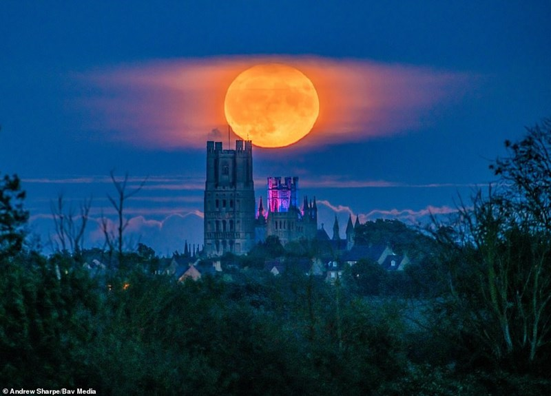 photo of hunter's moon over a cathedral