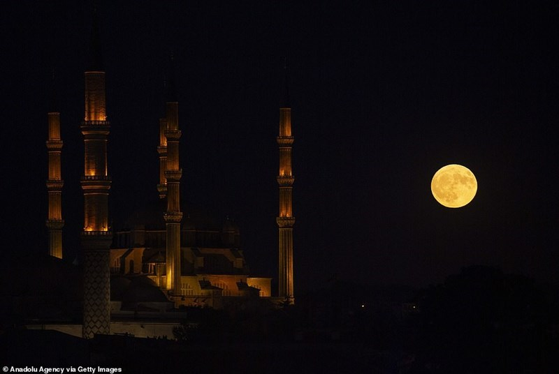 hunter's moon next to a beautiful mosque in turkey
