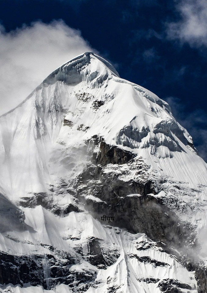 close up photo Mt Nilkanth covered in snow against blue sky india himalayas