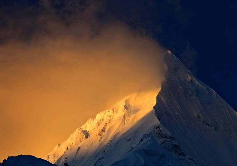 picture light hitting one side Panchchuli peaks india mountain