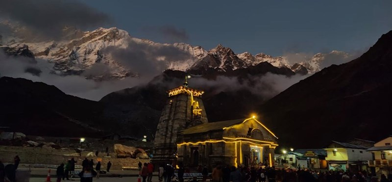 kedarnath temple at night lit up with snowy himalayas in background india