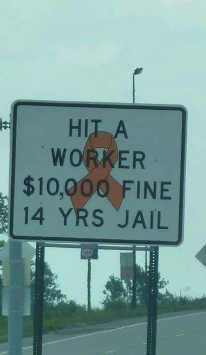 Street sign - HIT A WORKER $10,000 FINE 14 YRS JAIL