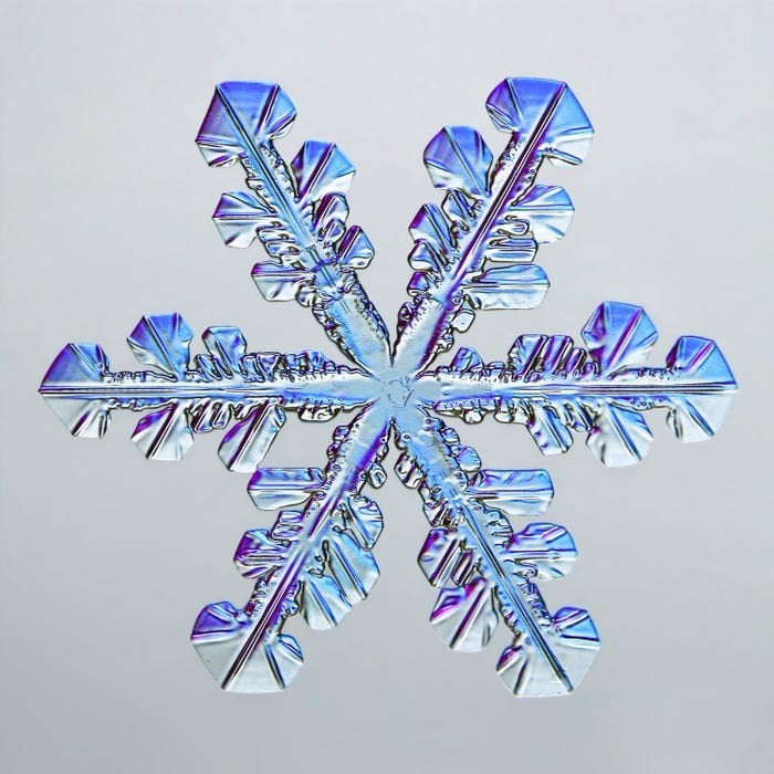 a close up of a symmetrical snowflake