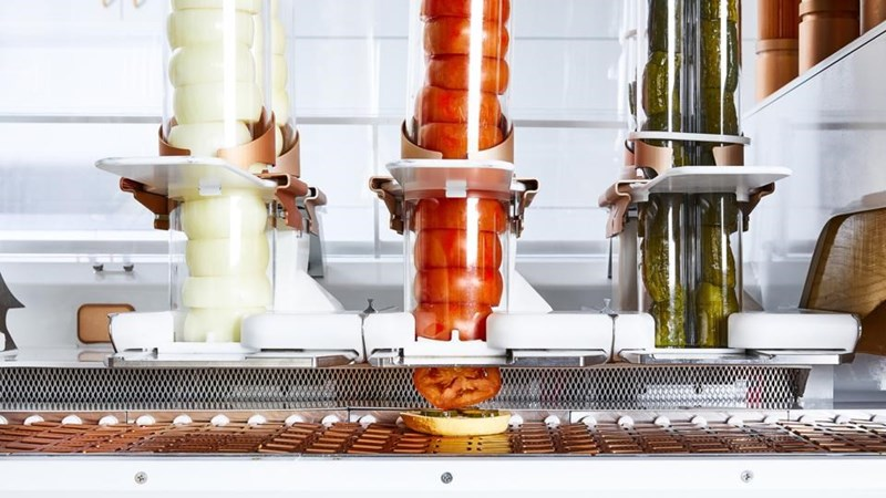 picture onions and tomatos inside glass tubes in burger robot