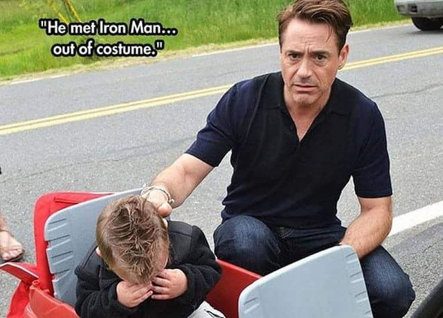 Sitting - He met Iron Man.o out of costume