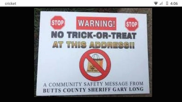 Text - cricket 4:06 STOP WARNING! STOP NO TRICK-OR-TREAT AT THIS ADDRESSI! A COMMUNITY SAFETY MESSAGE FROM BUTTS COUNTY SHERIFF GARY LONG