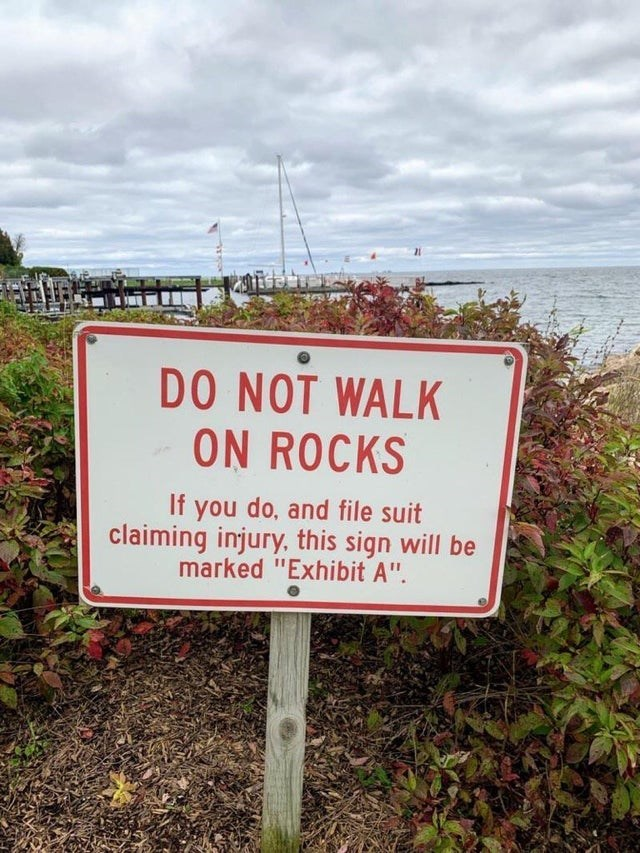 """Signage - DO NOT WALK ON ROCKS If you do, and file suit claiming injury, this sign will be marked """"Exhibit A""""."""