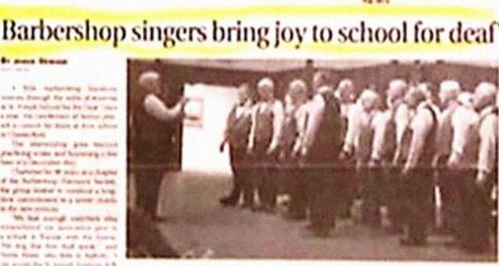 Text - Barbershop singers bring joy to school for deaf