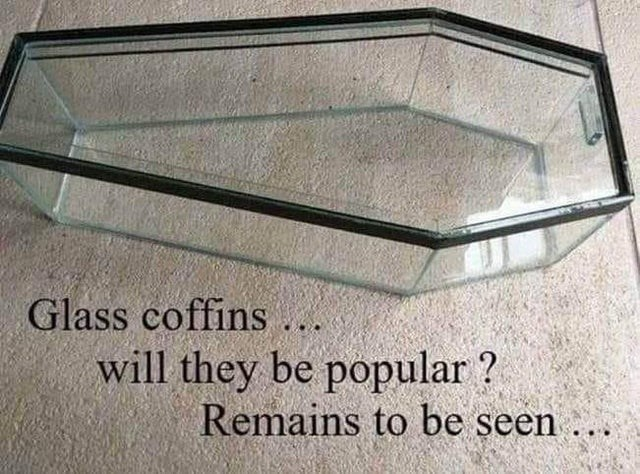 Table - Glass coffins will they be popular ? Remains to be seen ...