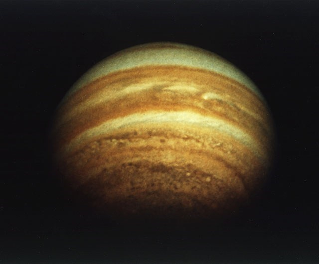 first photo of saturn taken by pioneer 11 funky retro vibe