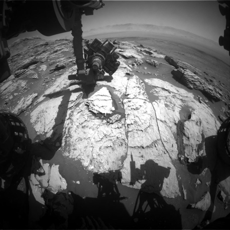 black and white photo shadow of curiosity rover on mars