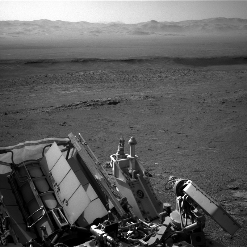curiosity rover on mars black and white inside crater