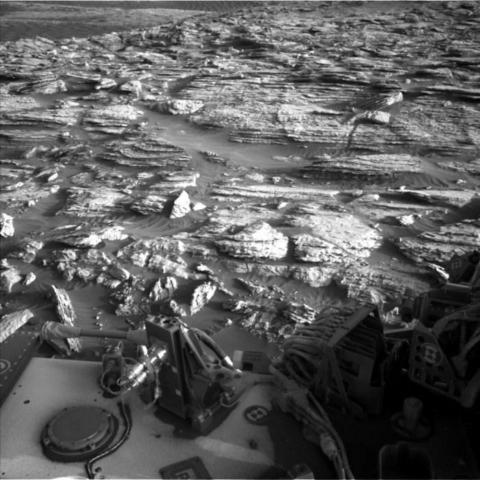 black and white photo rocky ground mars curiosity rover