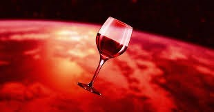 glass of red wine floating in space in front of red planet