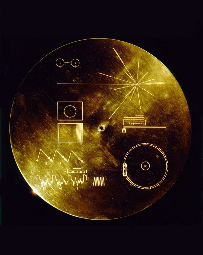 image golden plaque sent into space that has recorded sounds and images