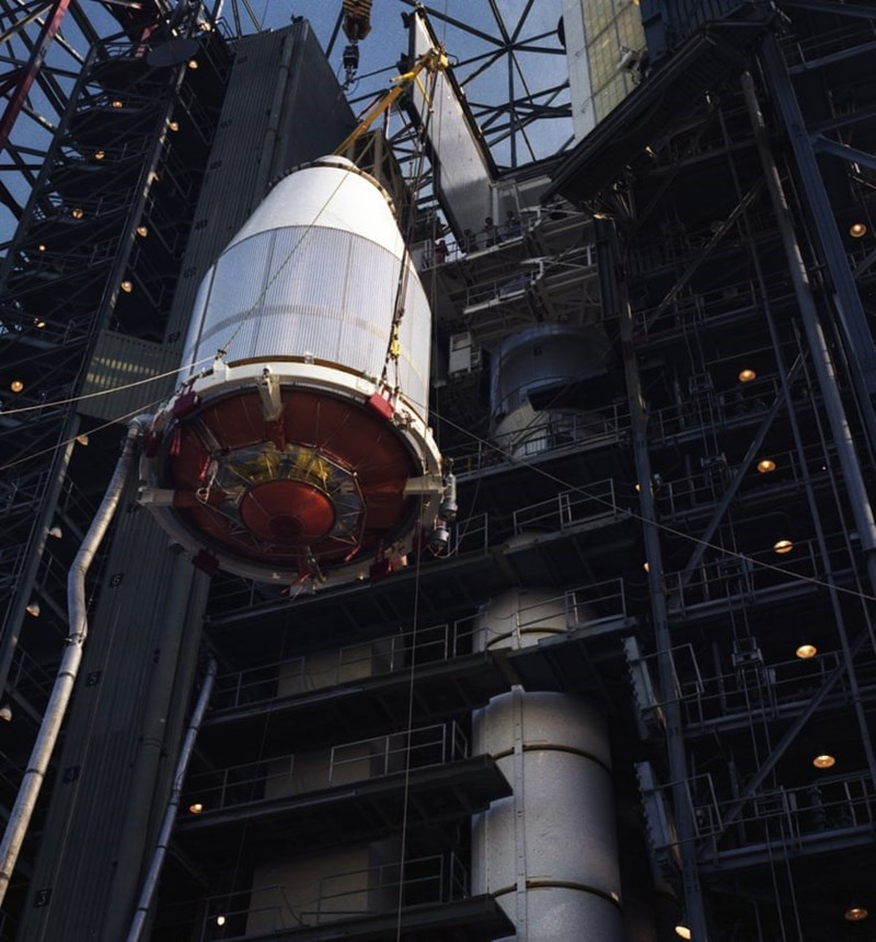 photo of voyager 2 being attached to launch vehicle at kennedy space center