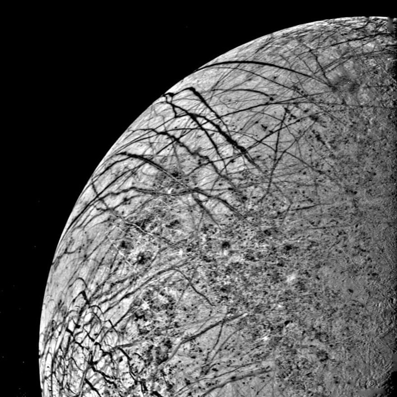 first photo of jupiter's moon europa black and white