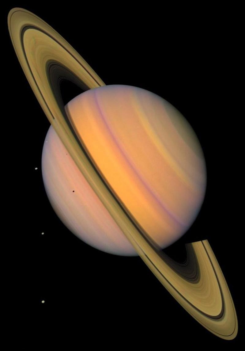 photo pink saturn on diagonal angle moons