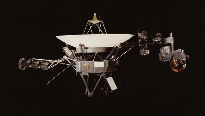 photo of voyager 2 in space with black background