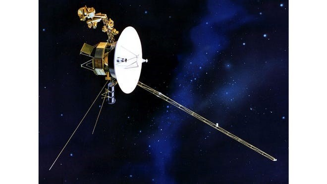 photo voyager 2 with black and blue starry universe behind it